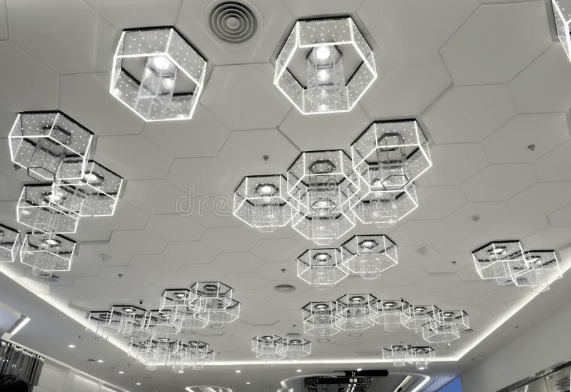 New type of cellular LED lighting used in modern commercial building. New type of cellular LED ceiling lighting used in modern commercial building stock photos
