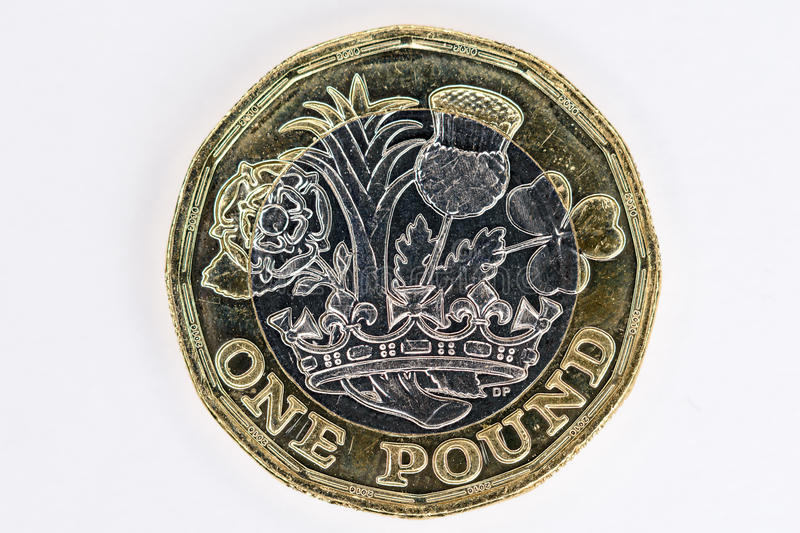 New UK pound coin. New UK twelve sided pound coin front royalty free stock photography