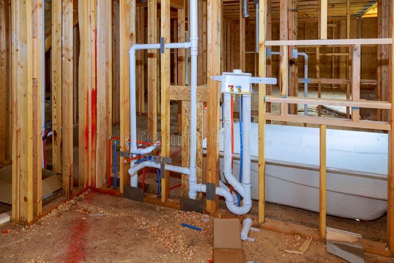 New under construction bathroom interior with interior framing of new house under construction stock photos