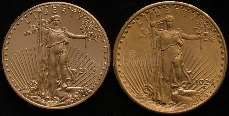 New US Gold Eagle Coin vs. Old US Gold Double Eagle Coin royalty free stock image