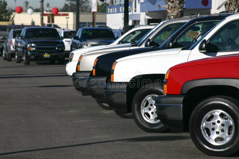 New and used autos. New and used trucks and autos at a dealership stock images
