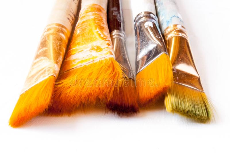 New and used bunch of paint brush on background. New and used bunch of paint brush on light white background. Selective soft fokus. Text copy space royalty free stock image