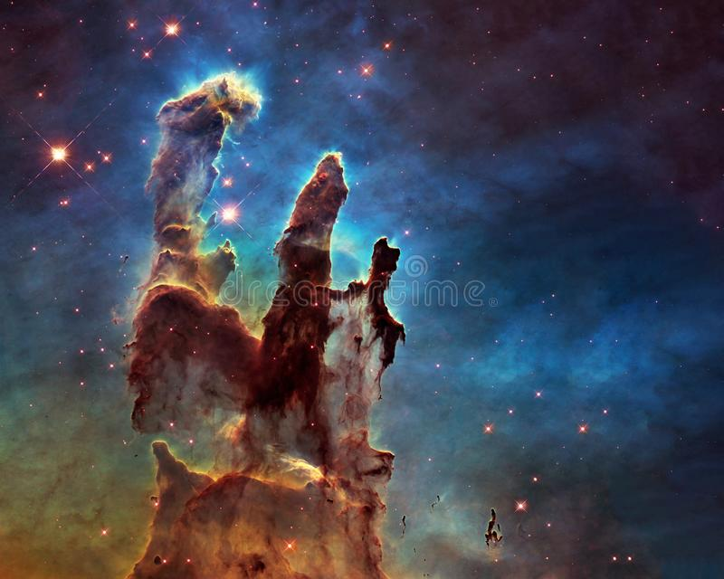 New view of the Pillars of Creation. Somewhere in space near Pillars of creation. Science fiction. Elements of this image were furnished by NASA/ESA royalty free stock image