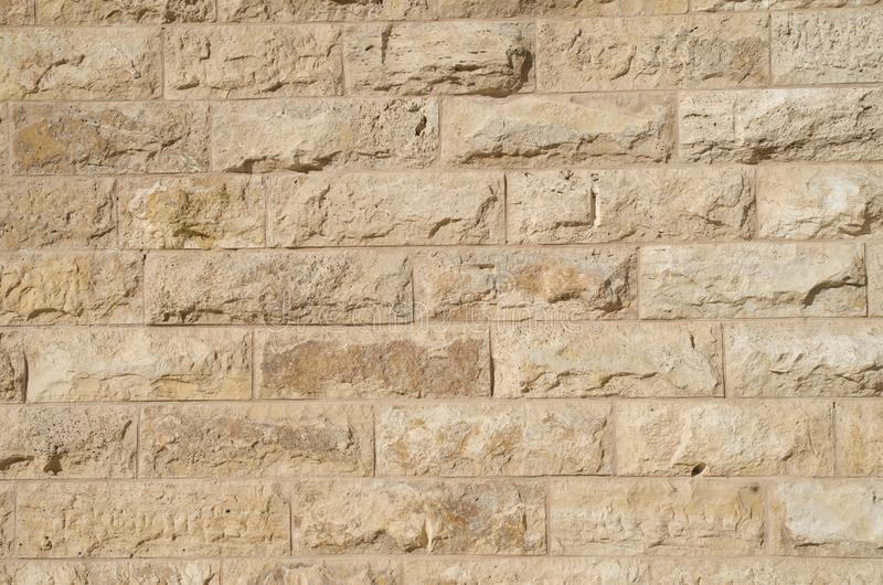 New wall of relief limestone closeup. New wall of relief orange limestone closeup royalty free stock photo