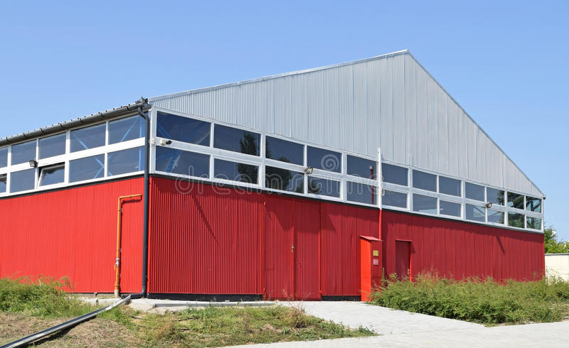 New warehouse building. Front side stock photography