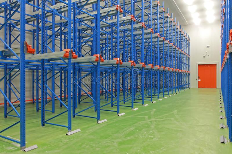 New warehouse shelf. Empty shelving system in new distribution warehouse royalty free stock photo