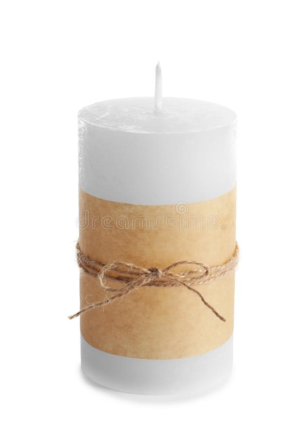 New wax candle decorated with parchment. On white background stock photography
