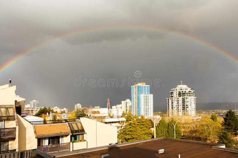 New Westminster, Canada - Circa 2017: A Large Rainbow over the c. New Westminster, Canada - Circa 2017: Large Rainbow over the city royalty free stock images