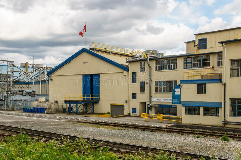 NEW WESTMINSTER, CANADA - JUNE 7, 2019: Building and infrastructure of the Kruger Products manufacture. NEW WESTMINSTER, CANADA - JUNE 7, 2019: Building and stock photos