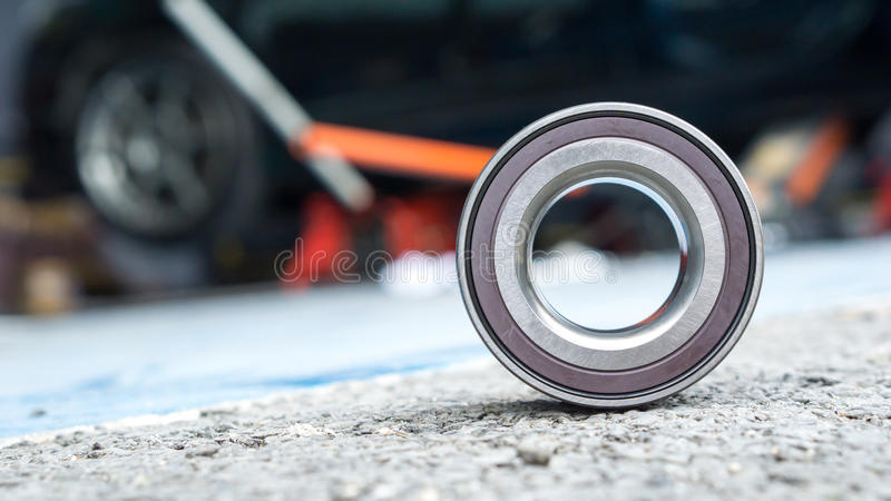 New wheels car bearing on asphalt floor in garage and copyspace. Car Suspension and car bearing parts concept - New wheels car bearing on asphalt floor in garage royalty free stock photos