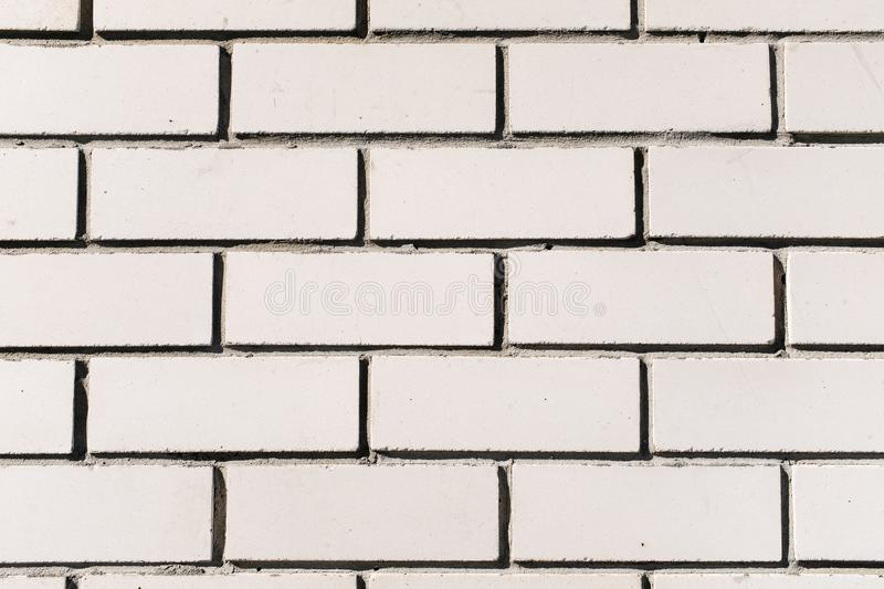 New white brick wall, clean, with smooth plaster. Updated facade of the building. Abstract banner. Brickwork, background, texture stock images