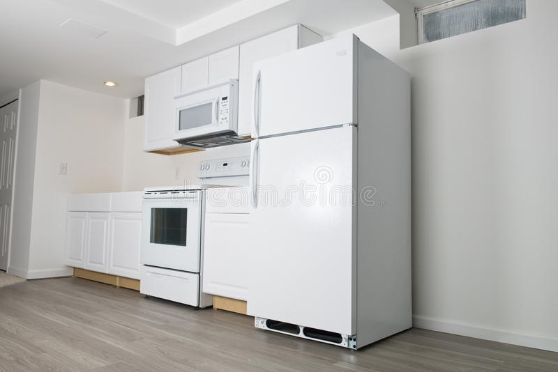 New White Kitchen Remodel, Home Improvement. A new white kitchen install and remodel. many people like to update and do remodeling in their house or home to keep stock image