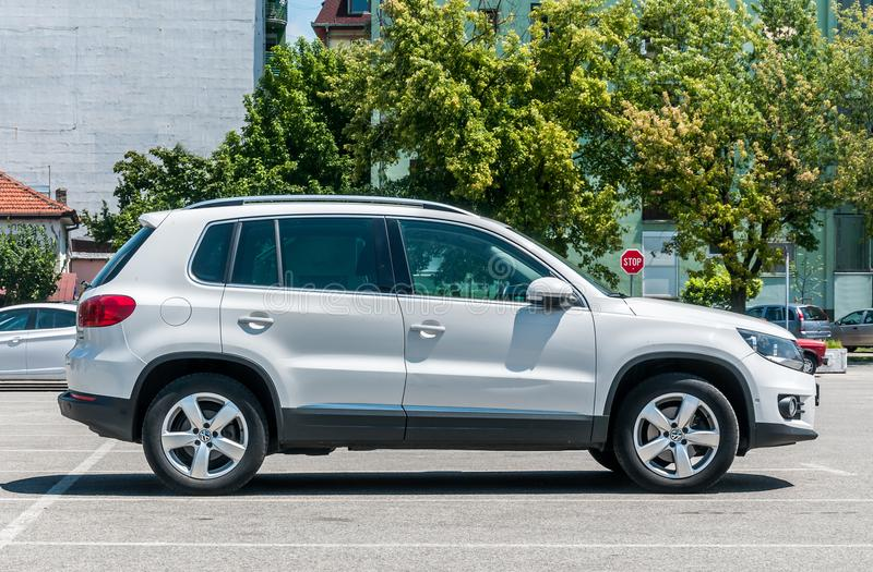New white luxurious VW Volkswagen Tiguan 4x4 2.0 TDI SUV car parked on the parking lot in the city. stock image