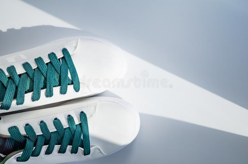 New white sneakers with green laces stock photos