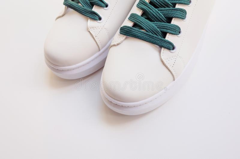 New white sneakers with green laces stock image