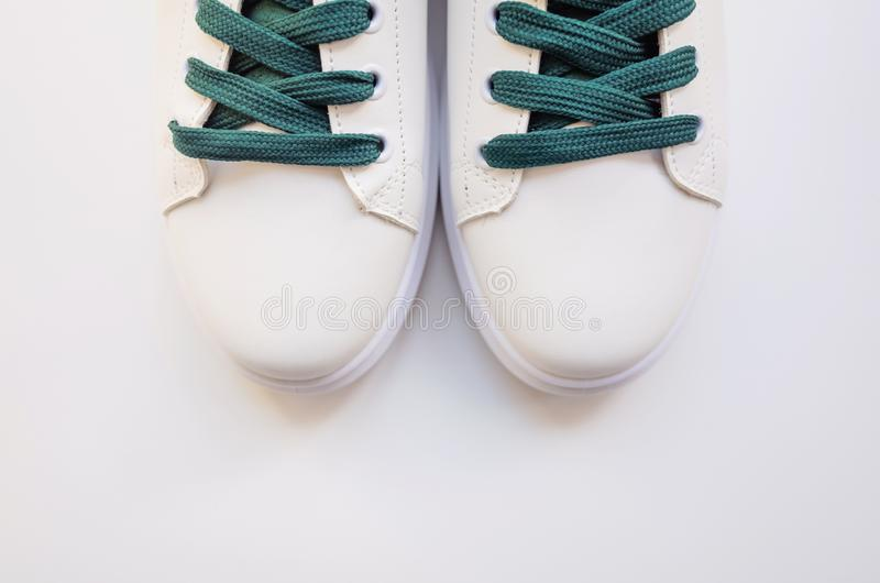 New white sneakers with green laces stock images