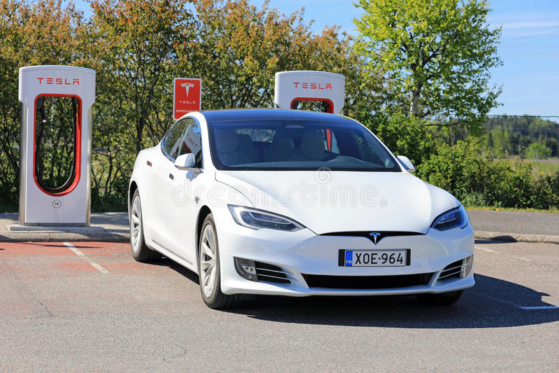 New White Tesla Model S Electric Car Charging stock images