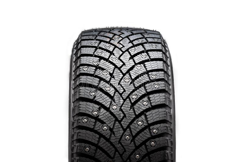 New winter studded tire, safety and premium quality. black background, close-up isolated royalty free stock photo