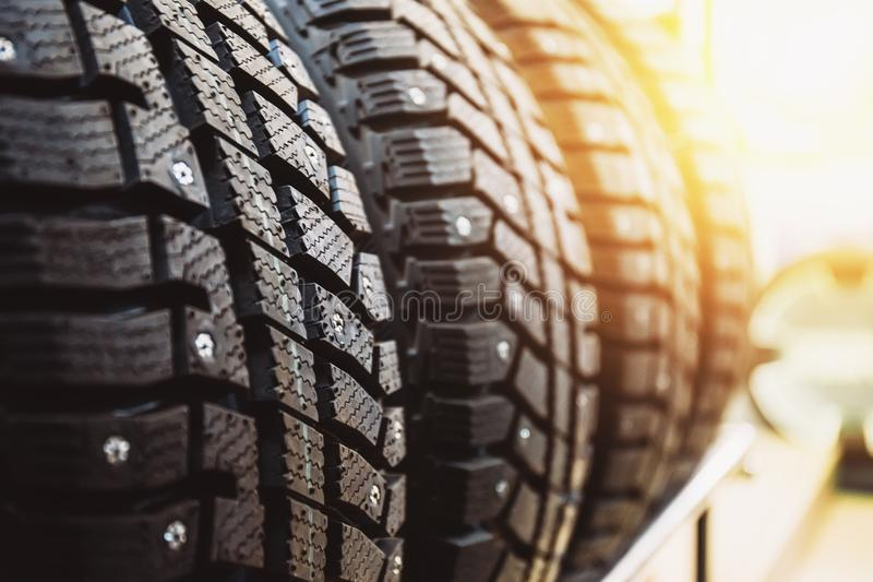 New winter tires for sale in store. Selective focus, sunlight effect royalty free stock photo
