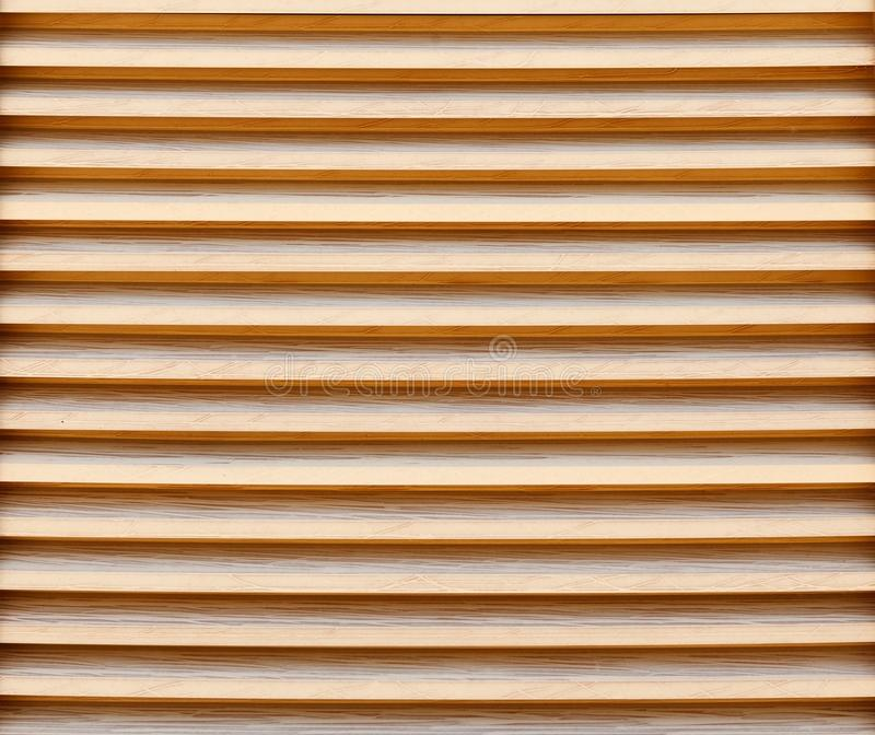 New wooden blinds close-up. Background image, texture royalty free stock photo
