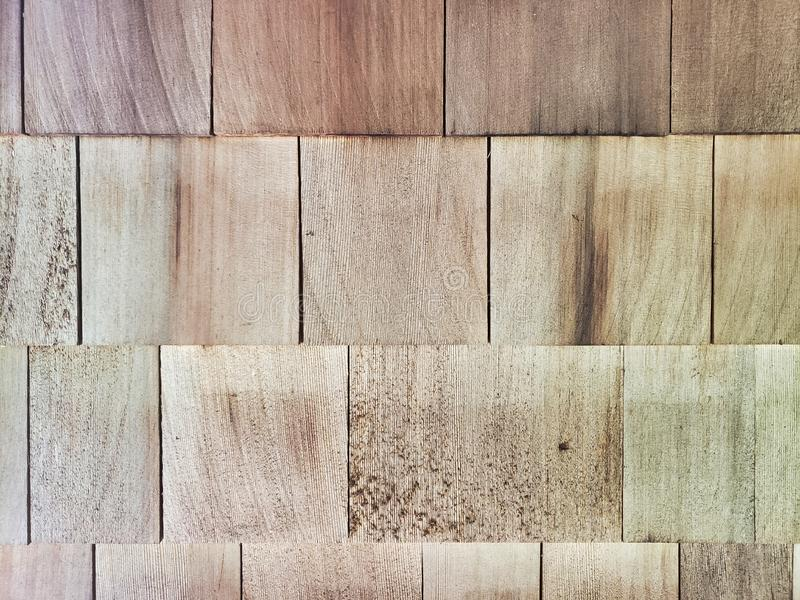 New wooden cedar siding on home close up texture. Take from a home in New England stock photo