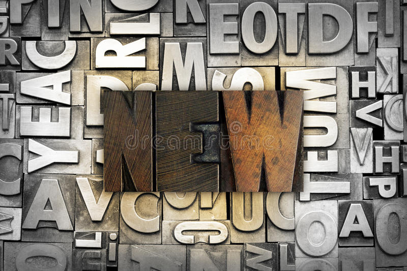 New. The word NEW written in vintage letterpress type stock photography