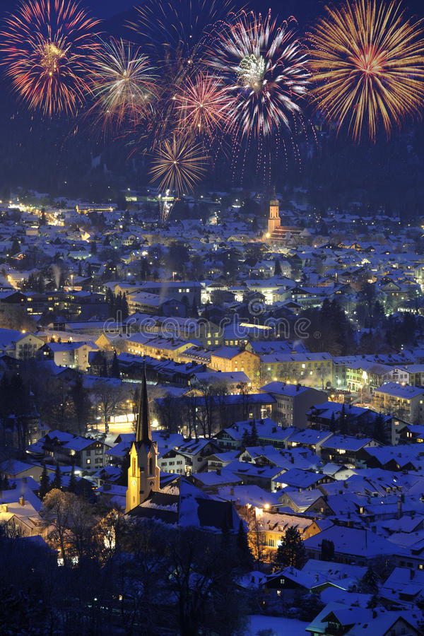 New year firework over Garmisch. New year firework over famous town garmisch-partenkirchen in germany royalty free stock image