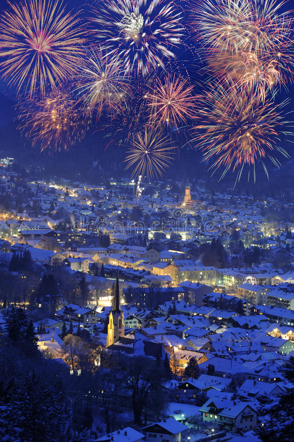New year 2011 firework. Over famous german town garmisch-partenkirchen in germany royalty free stock photography