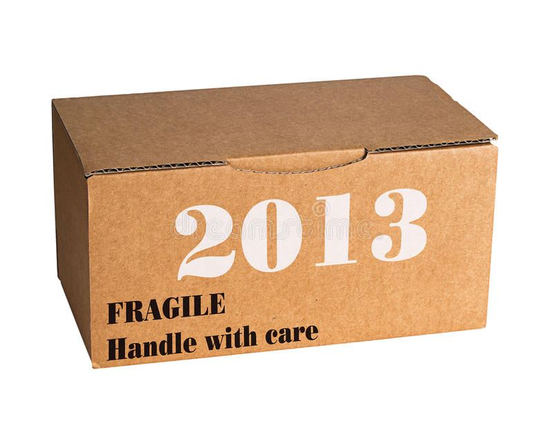 New year 2013 - fragile, with care. Cardboard box containing new year...as yet unopened stock photography