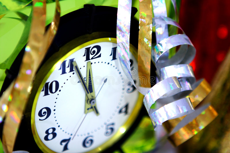 New Year. Clock and stream. 5 to 12 and.... New Year stock image