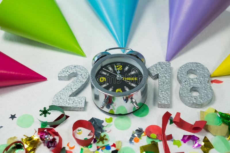 New year 2018 with alarm clock, decoration and party hat royalty free stock image