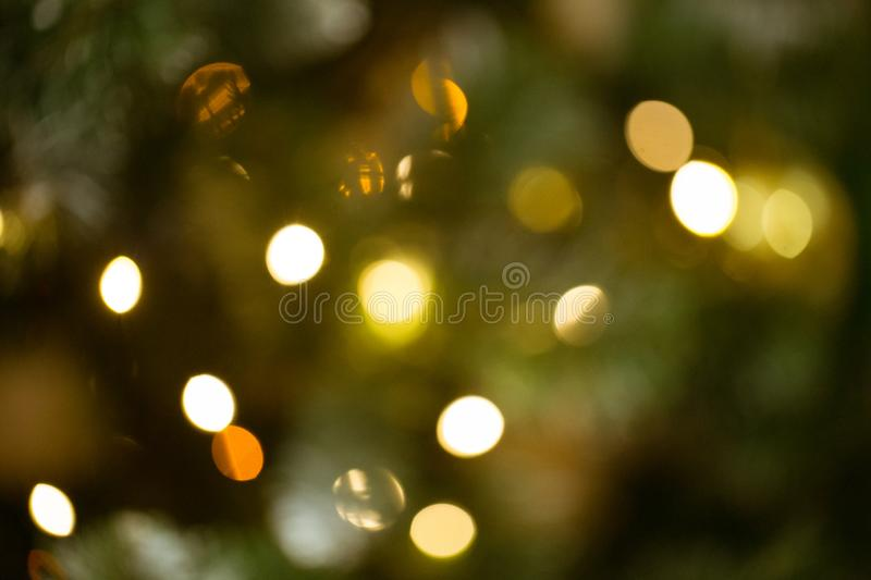 New year backdrop. Blurred background with golden bokeh. Christmas mock-up or greeting card. Holiday background. Soft focus royalty free stock photo