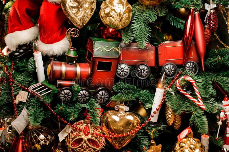 Background of fir tree with red toy train and christmas decoration royalty free stock image