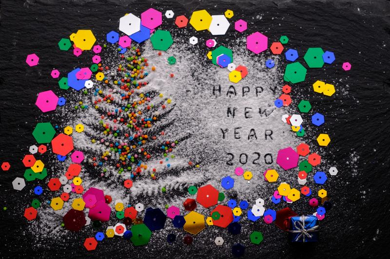 New Year 2020 background. Silhouette of flour on blackbackground royalty free stock photography