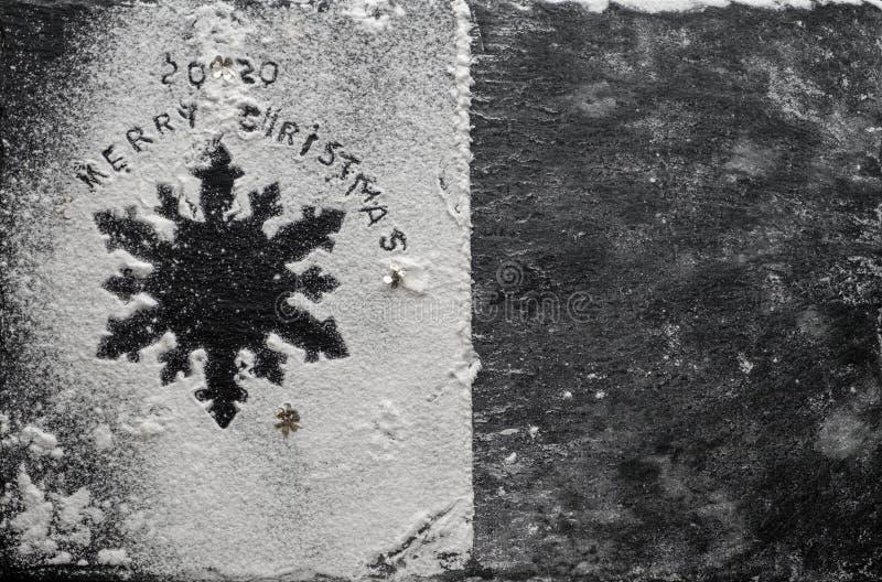New Year 2020 background. Silhouette of snowflake on blackbackground stock photo