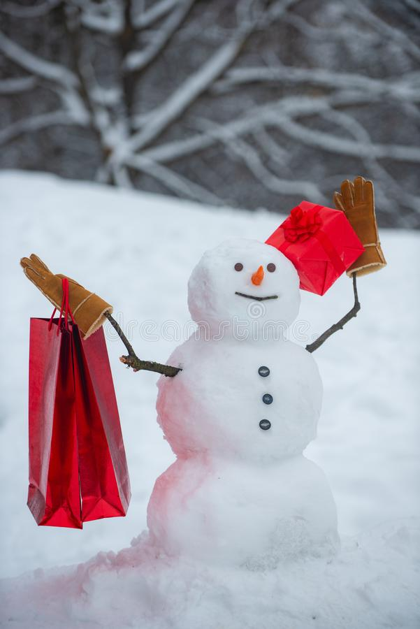 New Year banner. Delivery gifts. Cute snowmen with - gift presents standing in winter Christmas landscape. Snow man for stock images