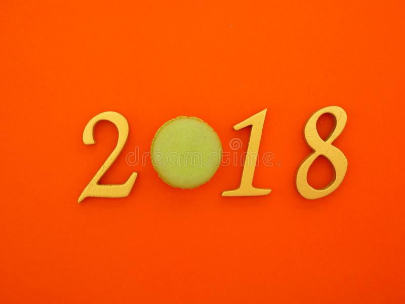 New Year 2018 Banner. A new year 2018 banner in gold on bright orange paper background stock photography