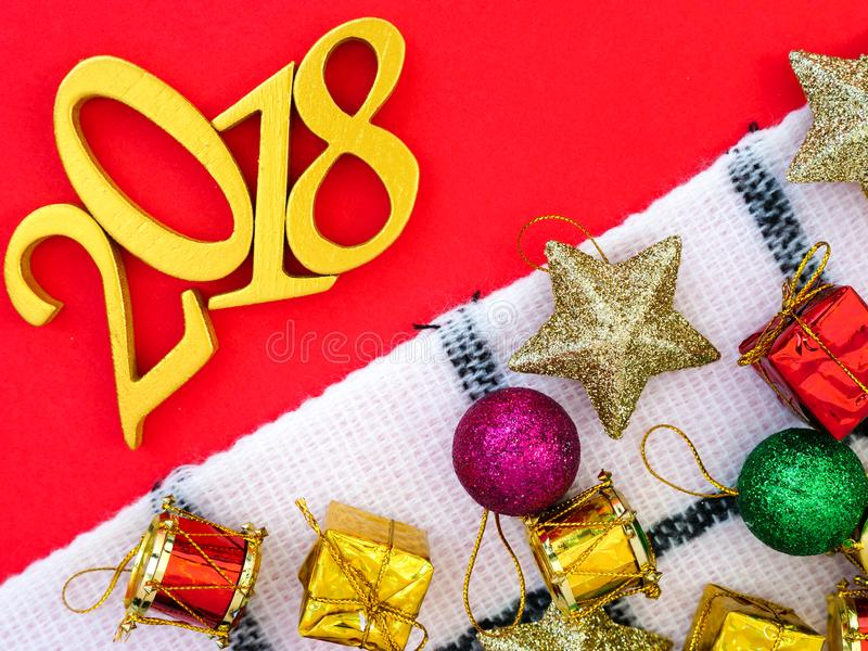 New Year 2018 Banner. A new year 2018 banner in gold with Christmas ornaments on bright red paper background stock image