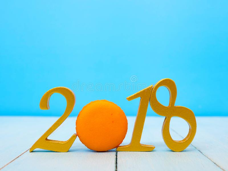 New Year 2018 Banner. A golden new year 2018 banner on pale blue wooden background royalty free stock photos