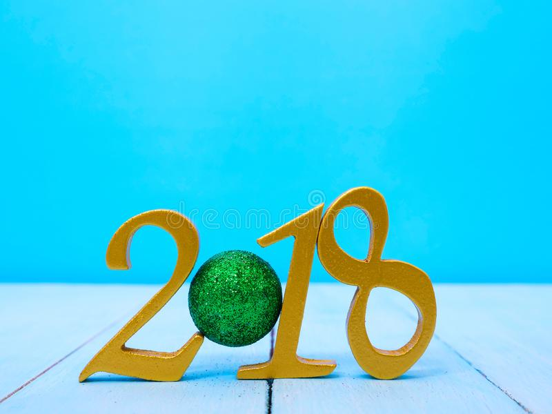 New Year 2018 Banner. A golden new year 2018 banner on pale blue wooden background royalty free stock photo