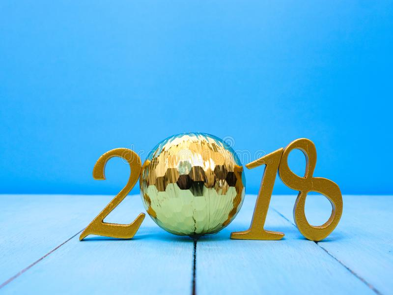 New Year 2018 Banner. A golden new year 2018 banner on pale blue wooden background stock photography