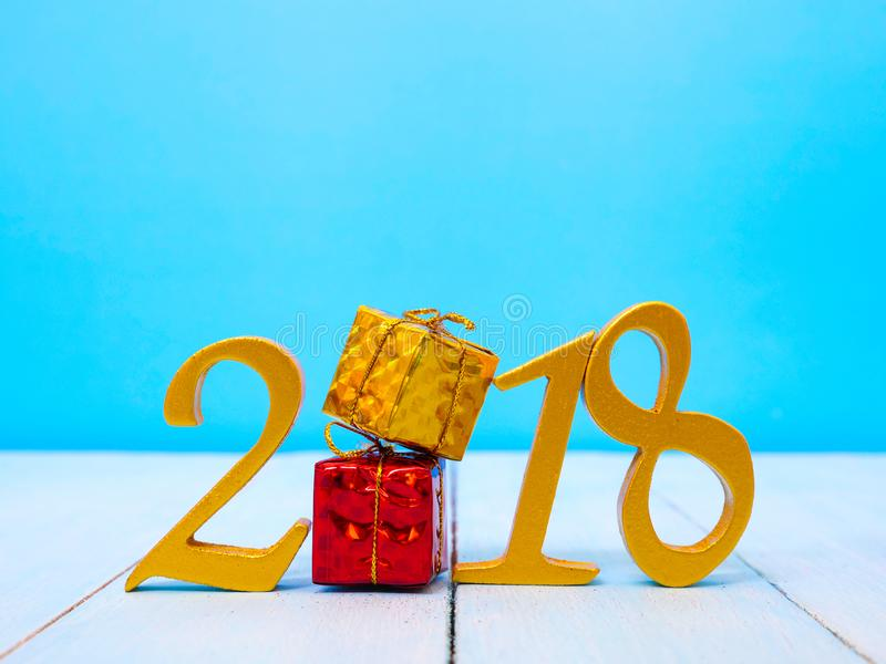 New Year 2018 Banner. A golden new year 2018 banner on pale blue wooden background stock photo