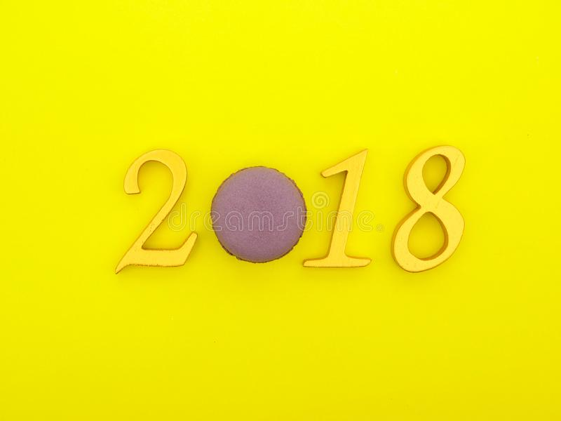 New Year 2018 Banner. A new year 2018 banner in gold on bright yellow paper background royalty free stock photo