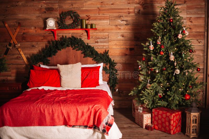 New year bedroom interior. Christmas tree, presents and other cozy decorations royalty free stock image