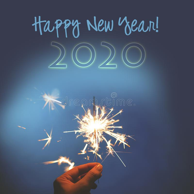 New Year blue background and sparkler for the year 2020 stock photo