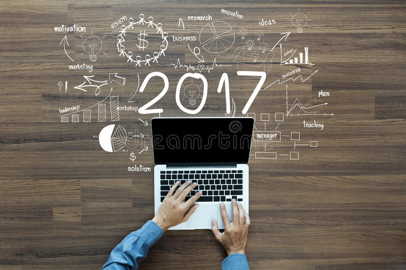 2017 new year business success. Creative thinking drawing charts and graphs strategy plan ideas wooden table background, Inspiration concept with businessman royalty free illustration