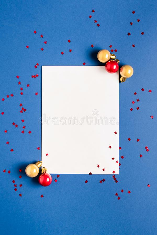 New Year card. Christmas concept with envelope and balls on a blue background. View from above royalty free stock photos