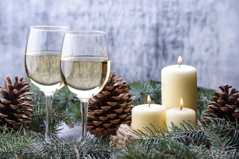 New Year card design with two glass-wine, candles and christmas royalty free stock images