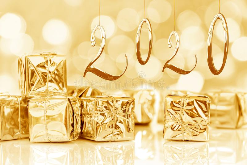 2020, new year card, small Christmas gifts in shiny golden paper stock photography