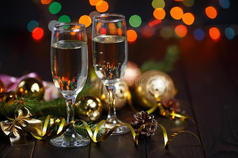 New year celebrating concept. Two glasses of champagne, fir tree stock photos